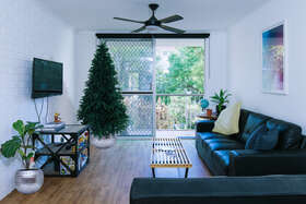 family room with large screen doors