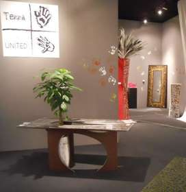 Table with PACHIRA plant and hourglass vase